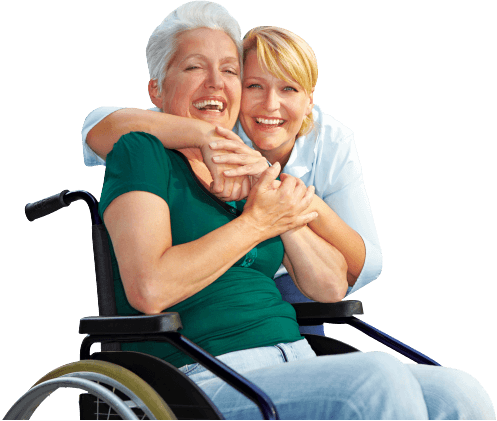 caregiver and woman in wheelchair smiling